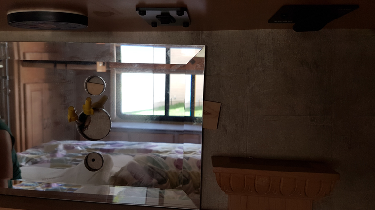 Mirror above bed in our Monaco motor coach