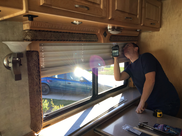 Kevin removing the window coverings