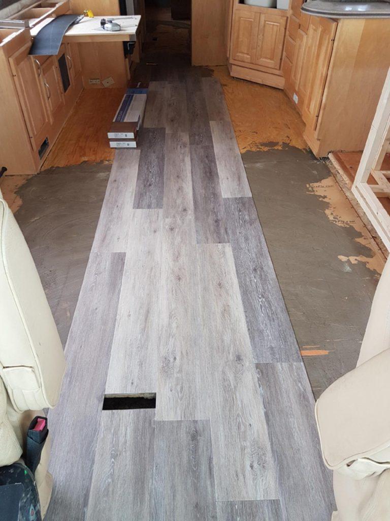 Installation of vinyl plank flooring in our Monaco