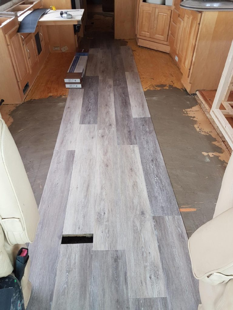 Installation of vinyl plank flooring in our Monaco