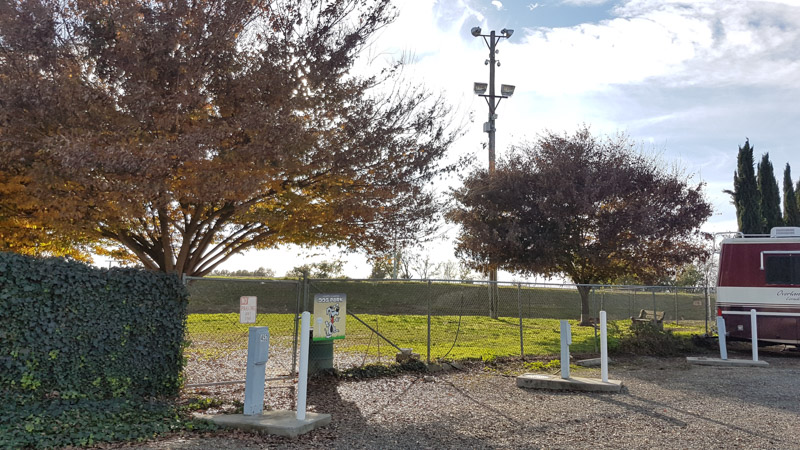 The fenced-in dog park at Cal Expo RV Park