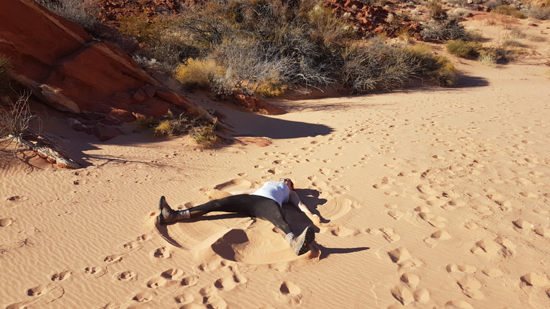 Making sand angels at Valley of Fire State Park