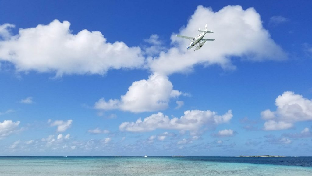 Float plane over Spoil Cay in The Bahamas