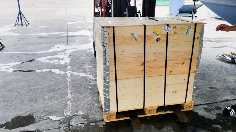 Fork lift and crate filled with JetThruster parts