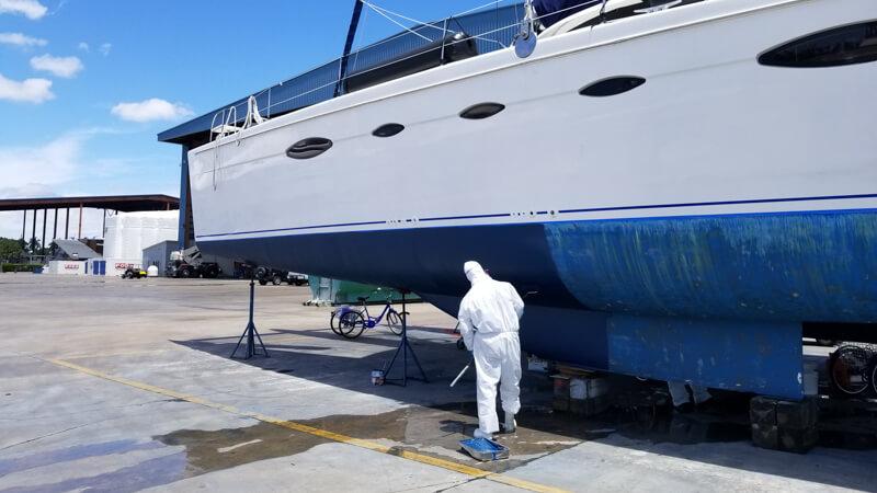 Catamaran getting bottom pain at LMC in Fort Lauderdale