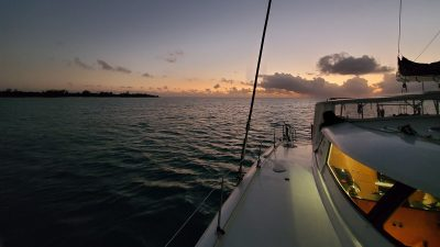 Seamlessly anchored in West Bay, New Providence Island during sunset